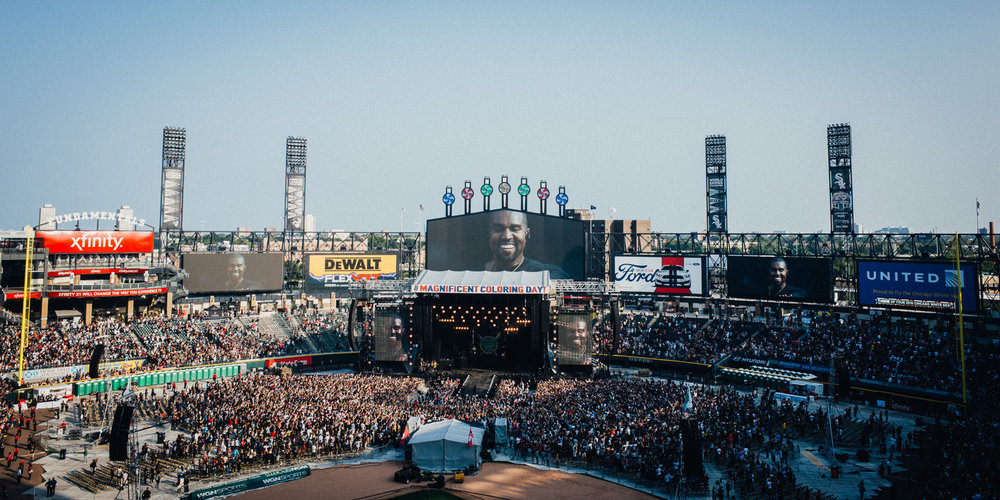 Kanye beams down upon Magnificent Coloring Day at US Cellular Field on Chicago's South Side.