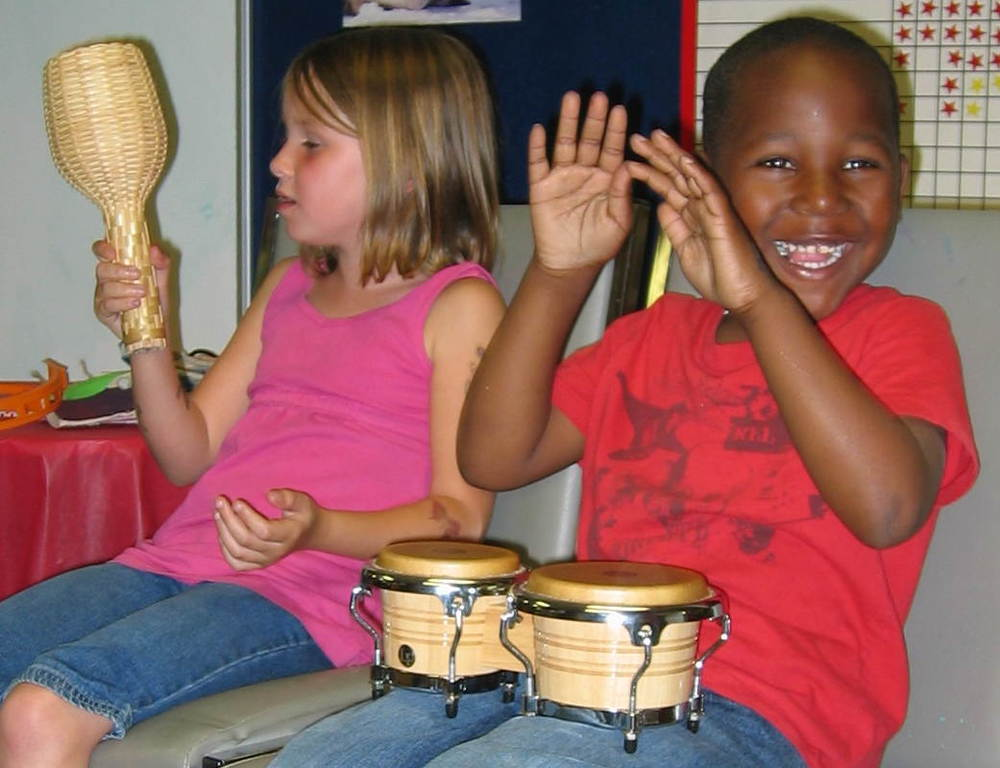 Boy_Plays_Bongos.jpg
