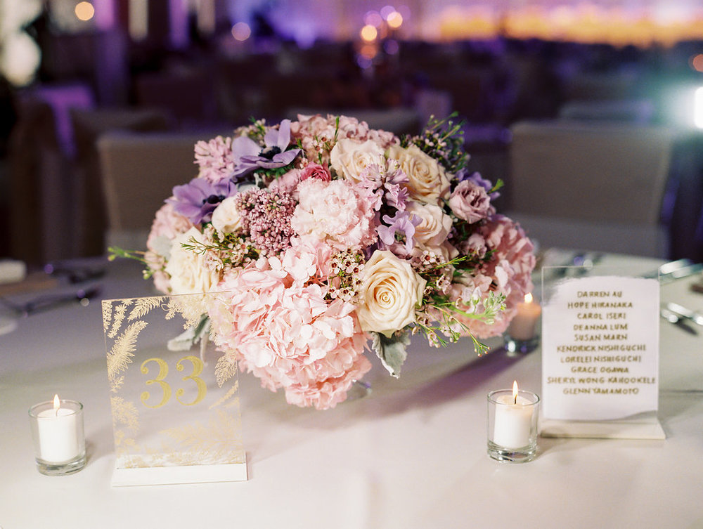 wedding-reception-table-bouquet-centerpieces-calligraphy-candles.jpg