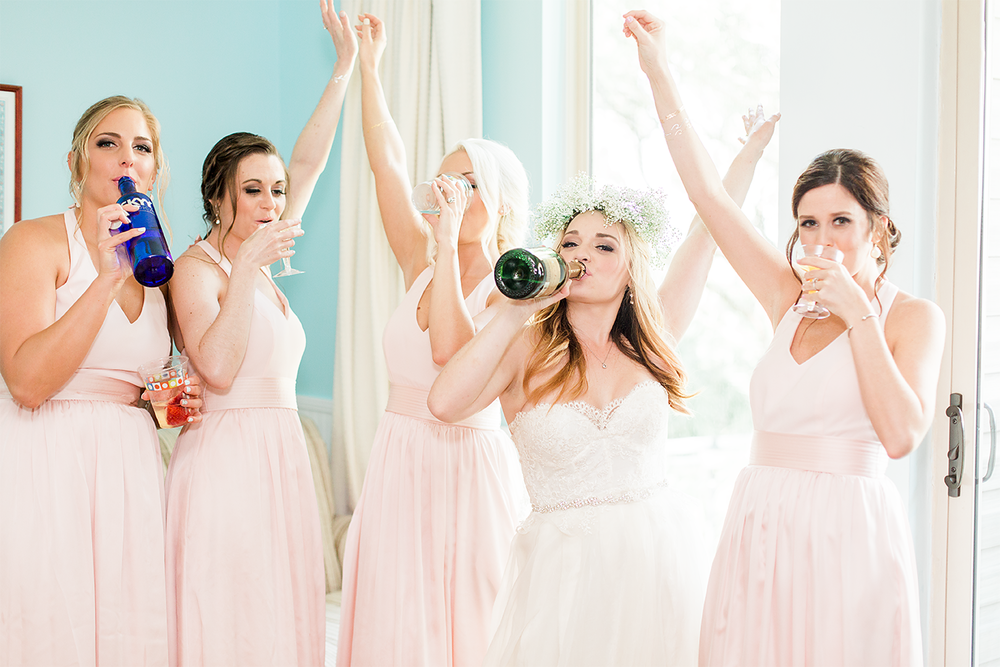 Celebrating the wedding with bridesmaids | Wedding in Driftwood Beach, Jekyll Island, GA | Maris Kirs Photography | Jacksonville, Ponte Vedra and St.Augustine wedding photographer