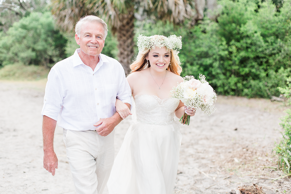 Bride and her dad walking down the isle on a beach wedding in Jekyll Island.
