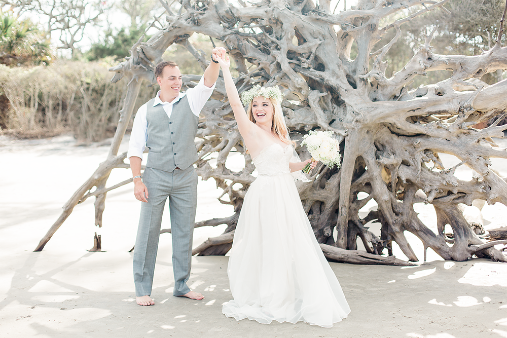 Bride and groom dancing in Driftwood Beach, Jekyll Island