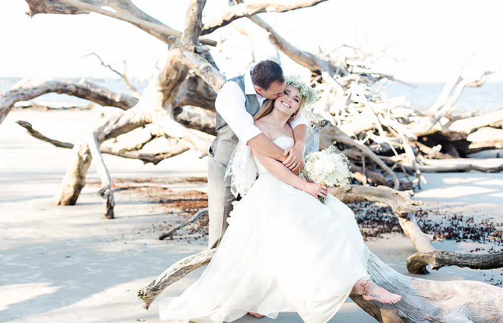 Bride and groom in Driftwood beach, Jekyll Island, GA