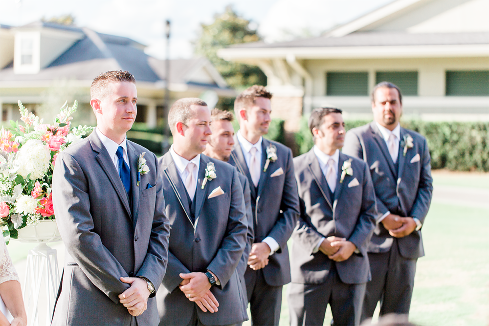 groom and groomsmen waiting for the bride to walk down the isle