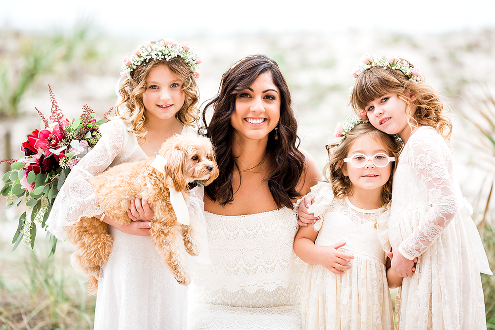 bride with flower girls and her dog who was part of the wedding