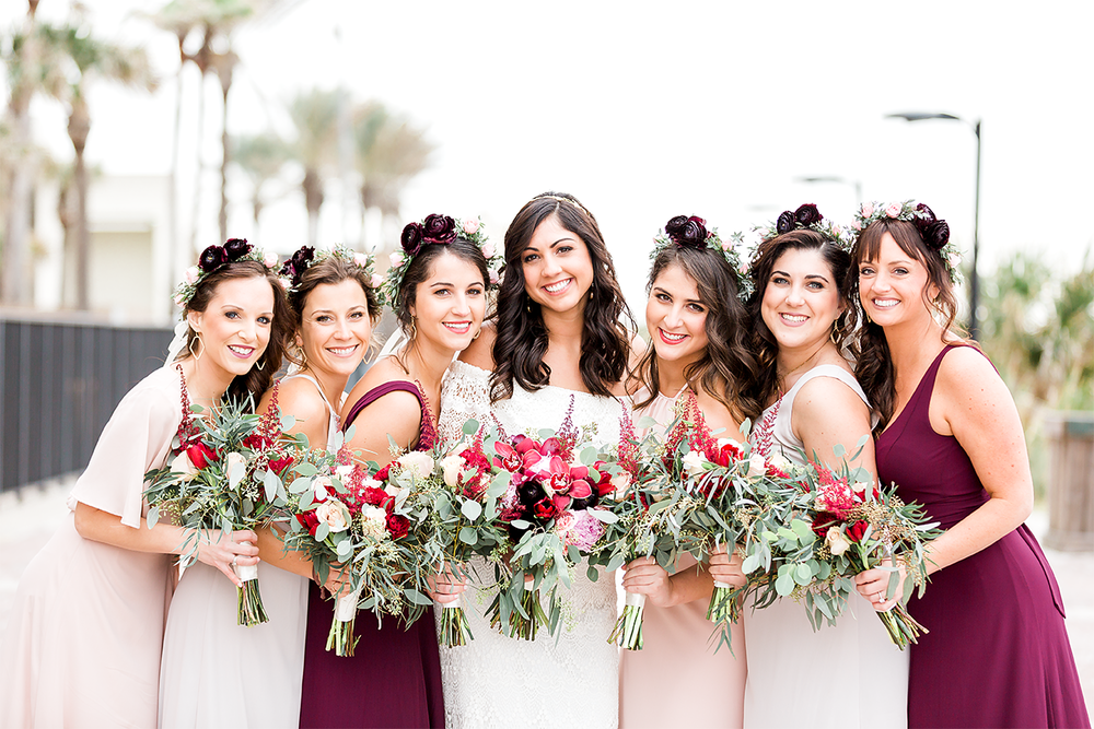 bridal party with their flower bouquets