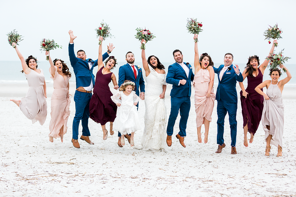 bridal party jumping picture at the beach