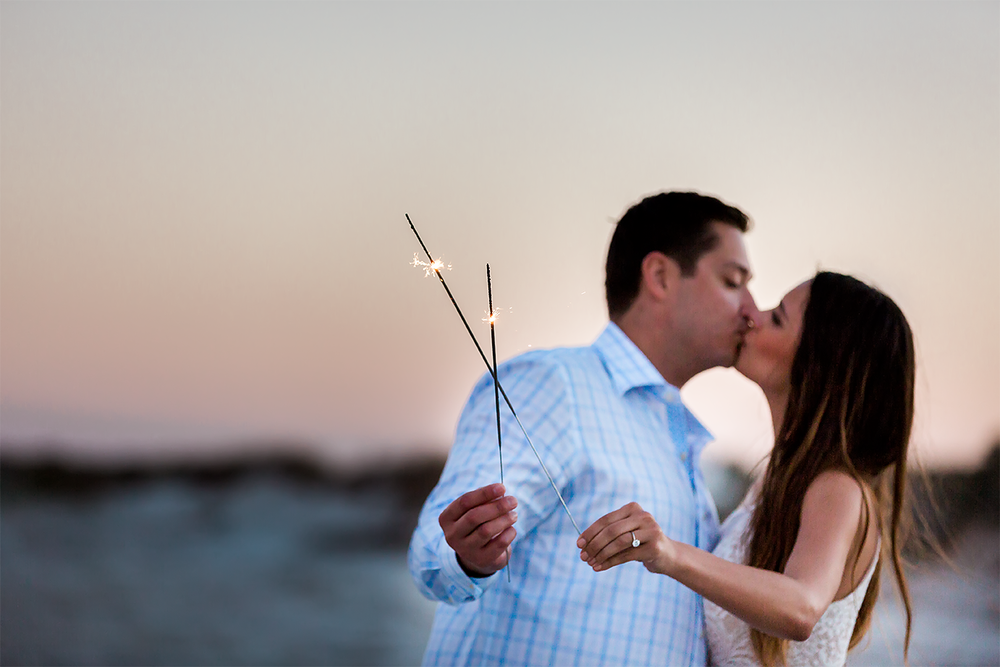 using sparklers at sunset beach engagement session in jacksonville fl