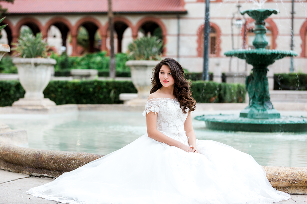 Quincenera portrait session in front of Casa Monica Hotel