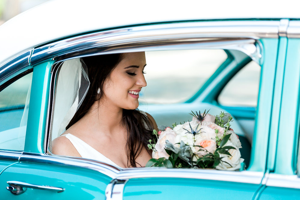 bride in a vintage car bellair