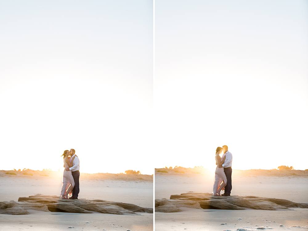 engagement pictures at sunset on the rocks at the beach