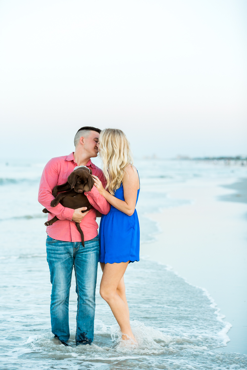 copule kissing with a dog at the beach.jpg