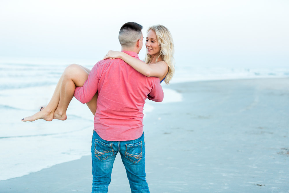 engagement pose ideas at the beach.jpg