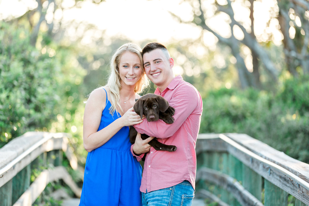 engagement session with a puppy in jacksonville beach.jpg