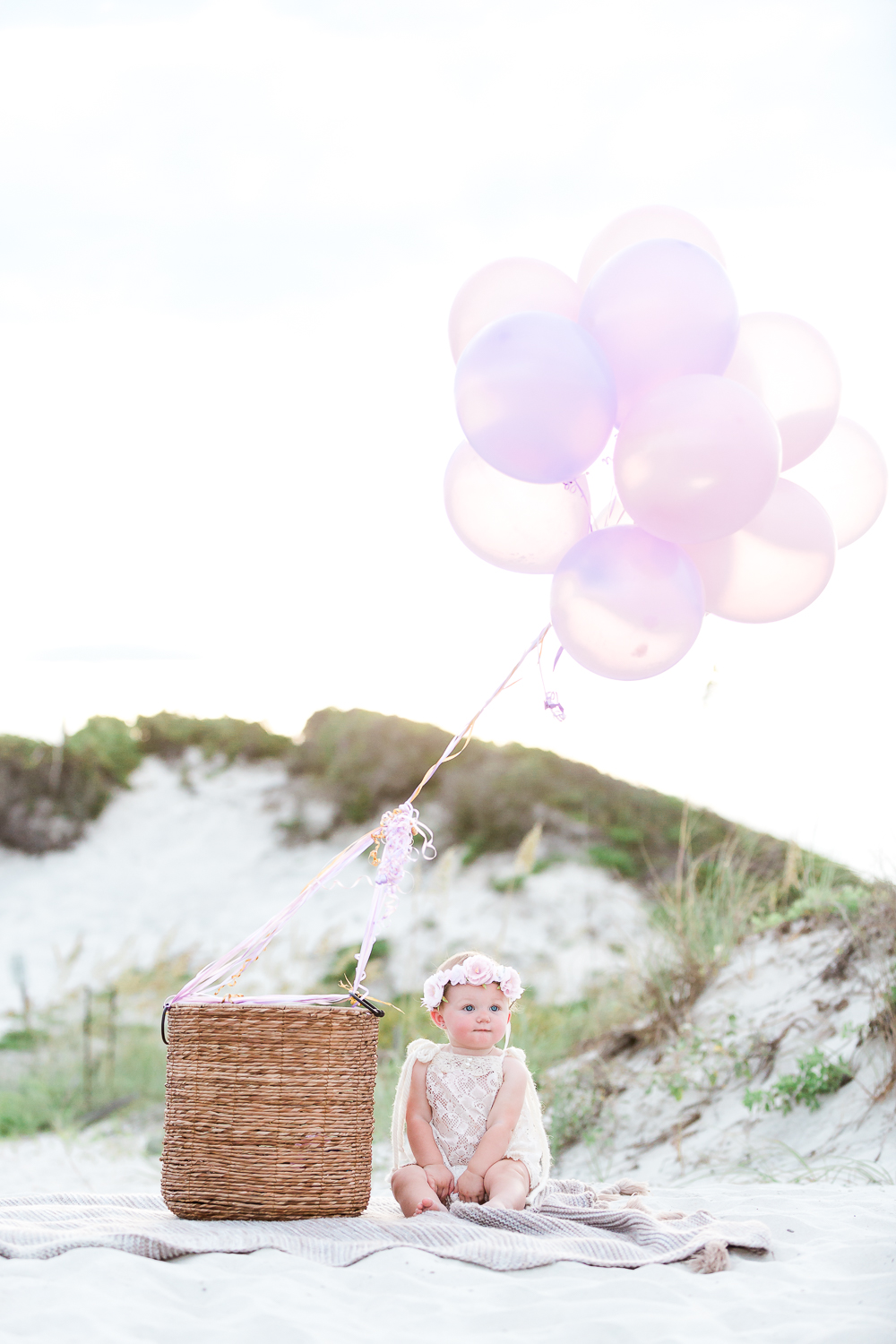 first birthday pictures at the beach with balloons