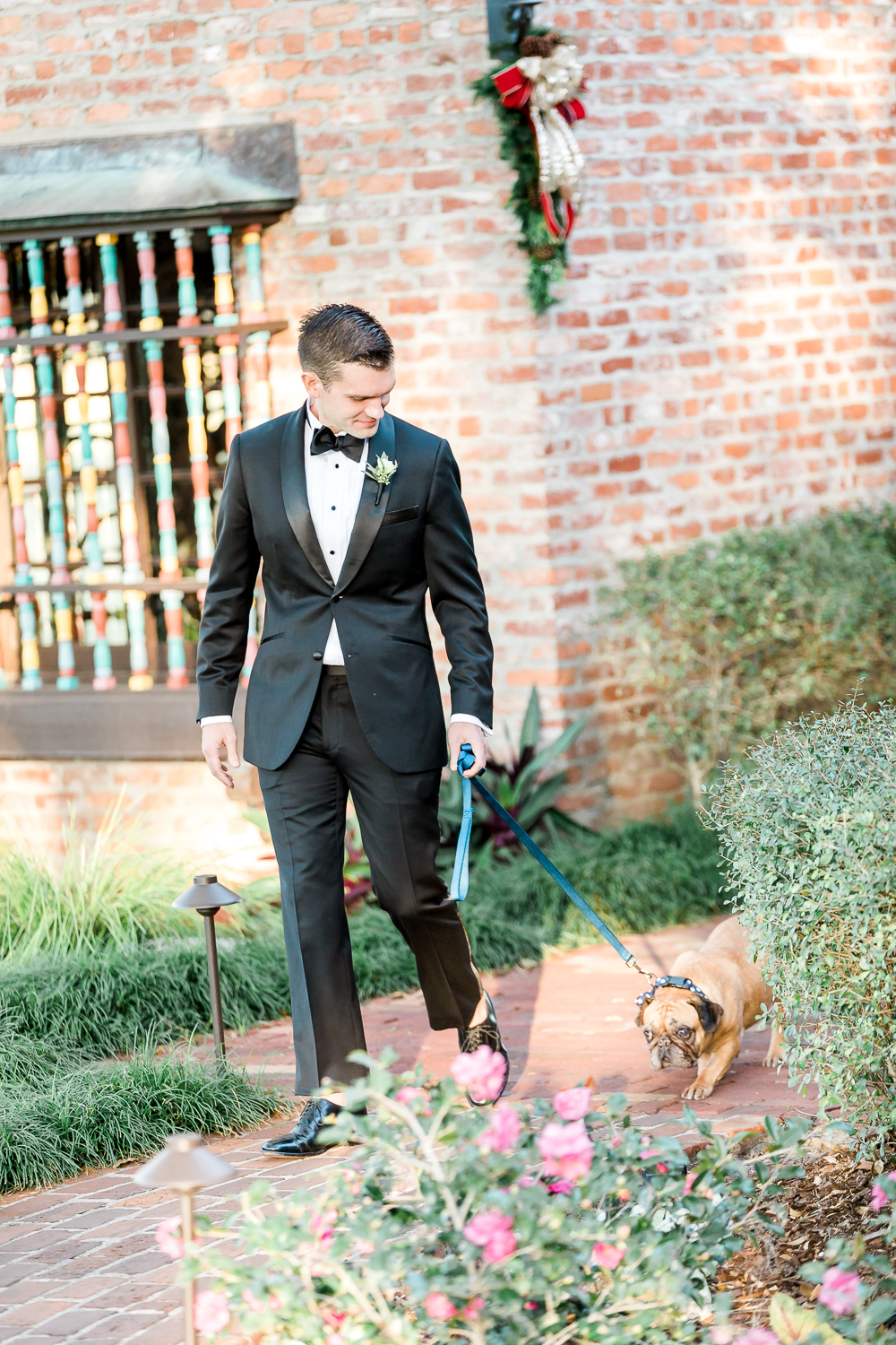 groom with his dog