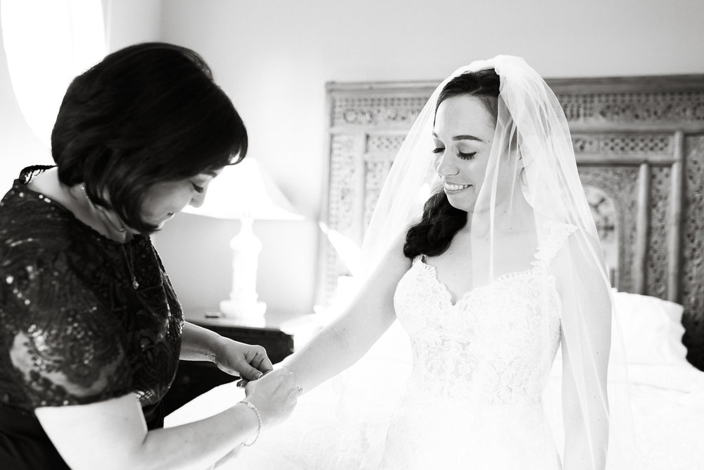 bride and her mom getting ready
