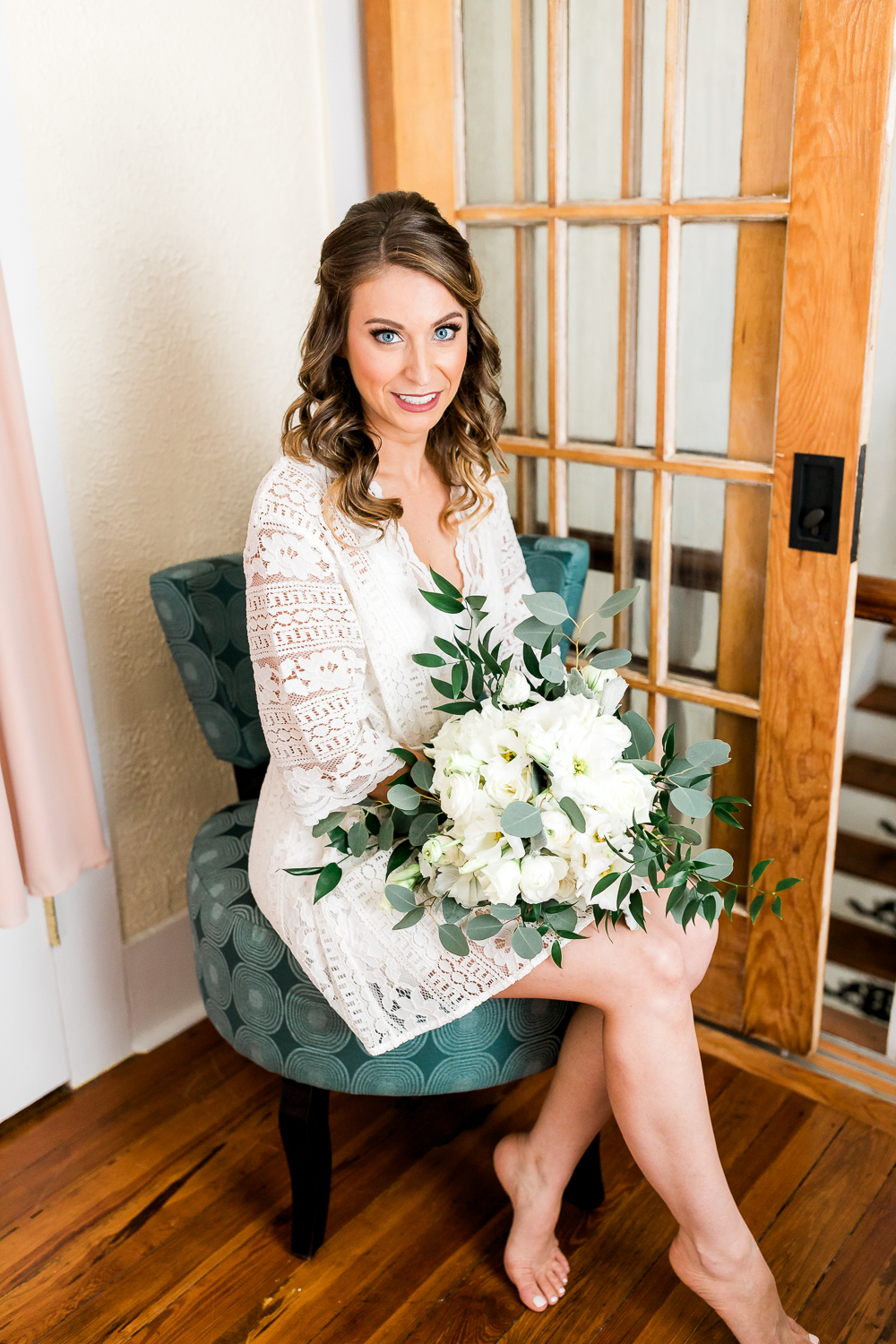 Bride with her bouquet from Flower Works
