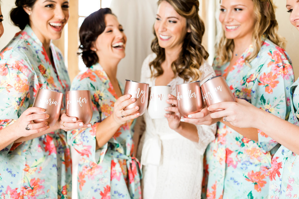 Bride and her bridal party getting ready for the white room wedding