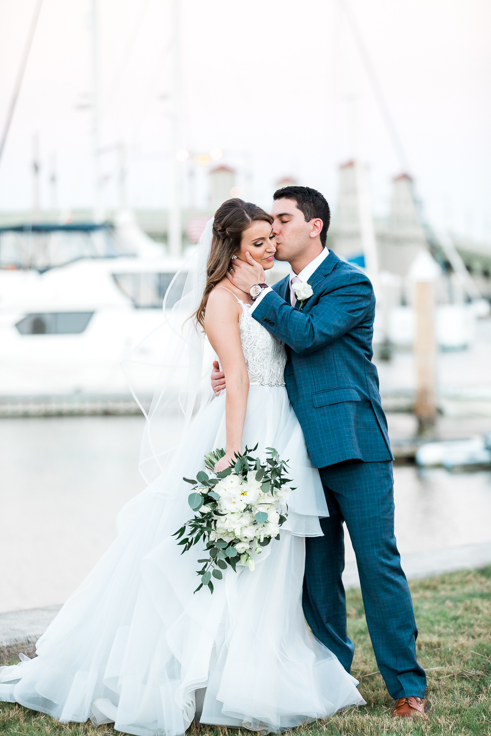 bride and groom's pictures by the marina in st.augustine