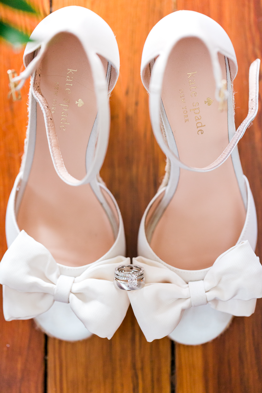 Kate Spade's white wedding shoes and wedding bands