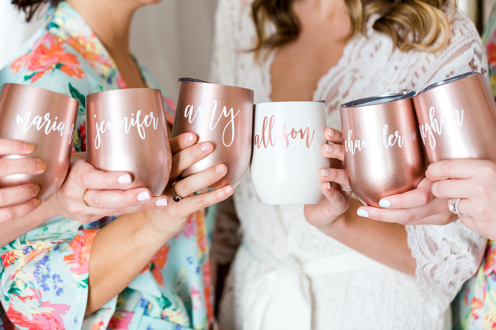 bridal party holding mason jars from The White Invite
