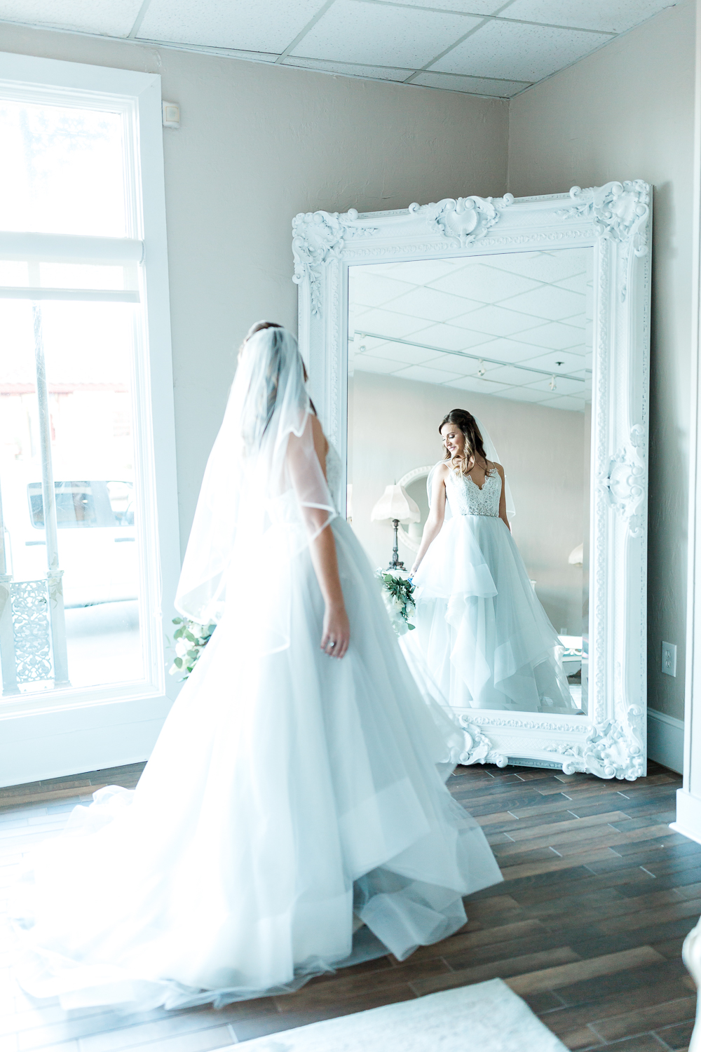 Bride in The White room's bridal suite