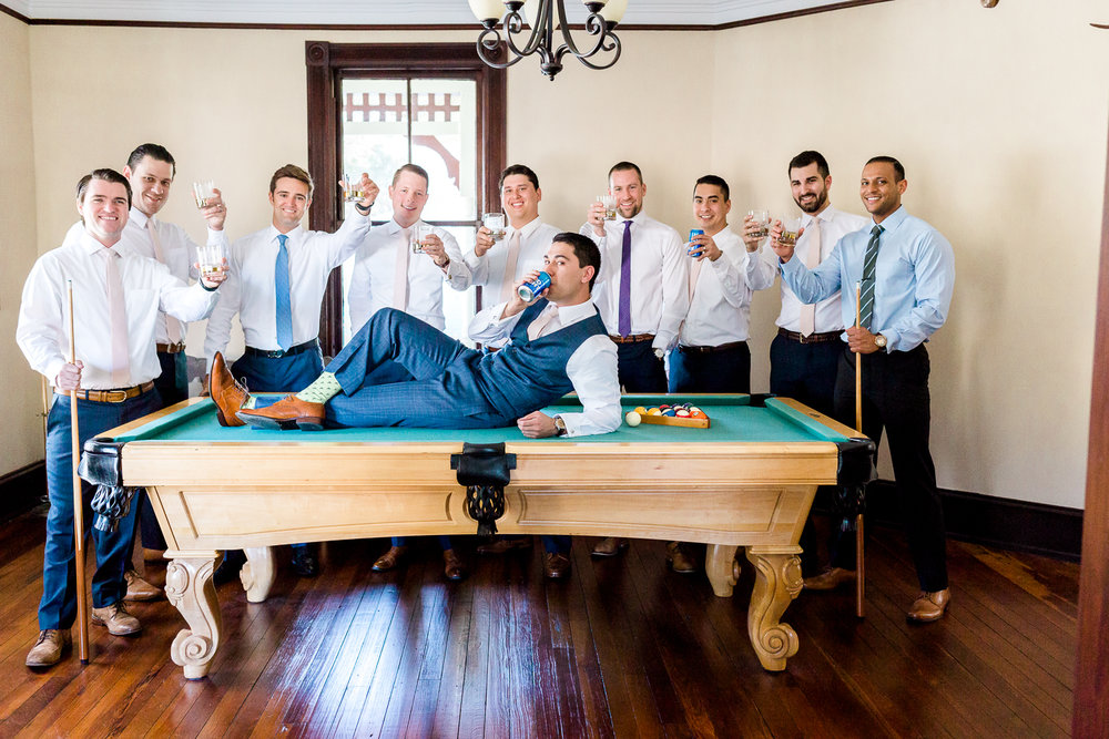 Groom and groomsmen on a pool table