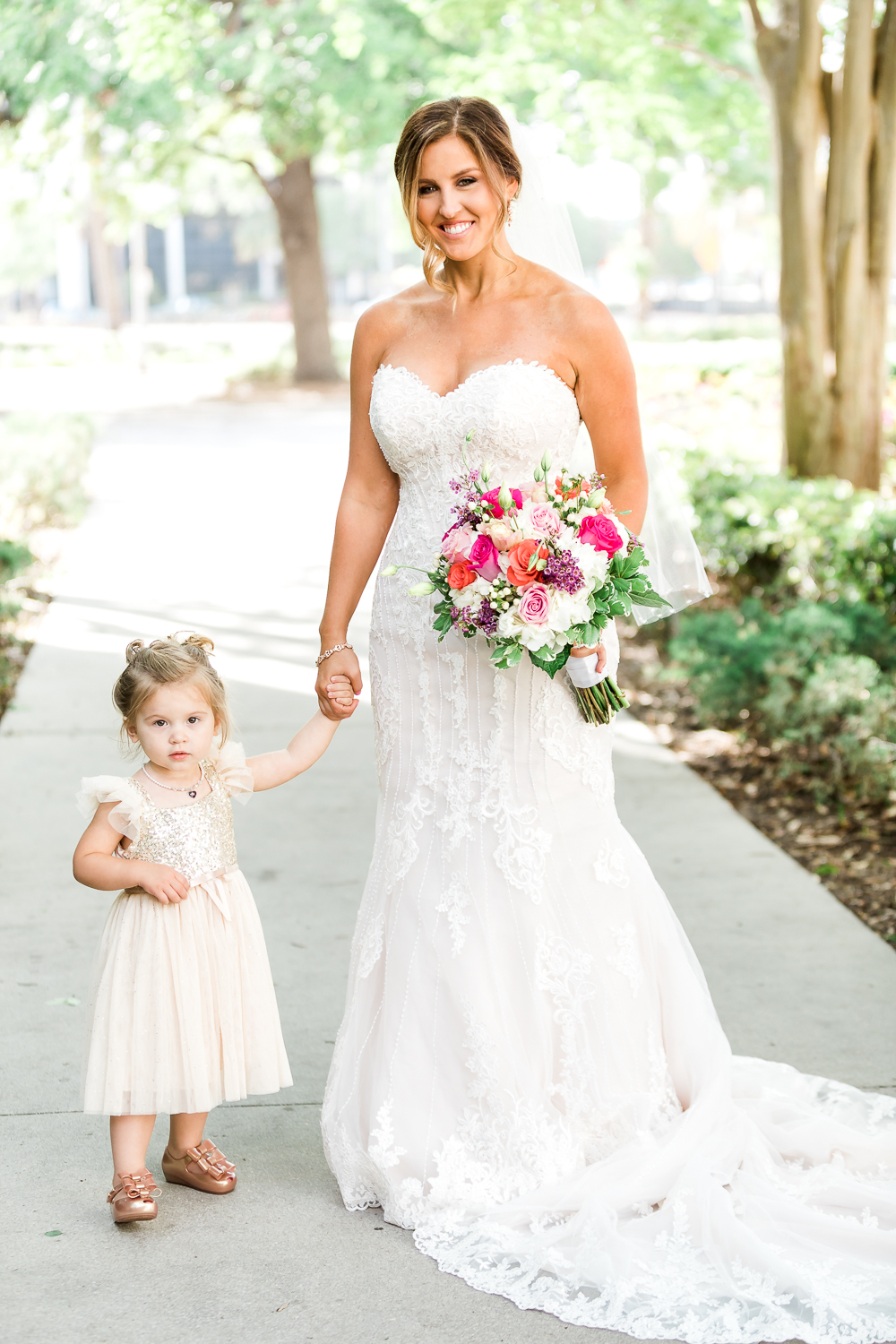Bride with her little flower girl in Jacksonville, FL