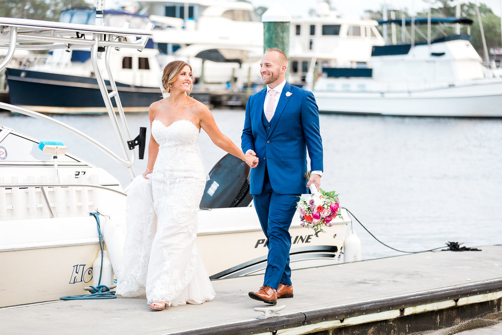 Bride and groom at the marina in Florida Yacht Club