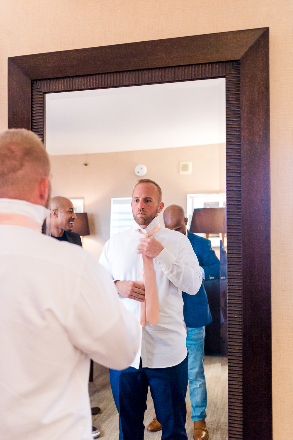 Groom getting ready in Omni downtown Jacksonville