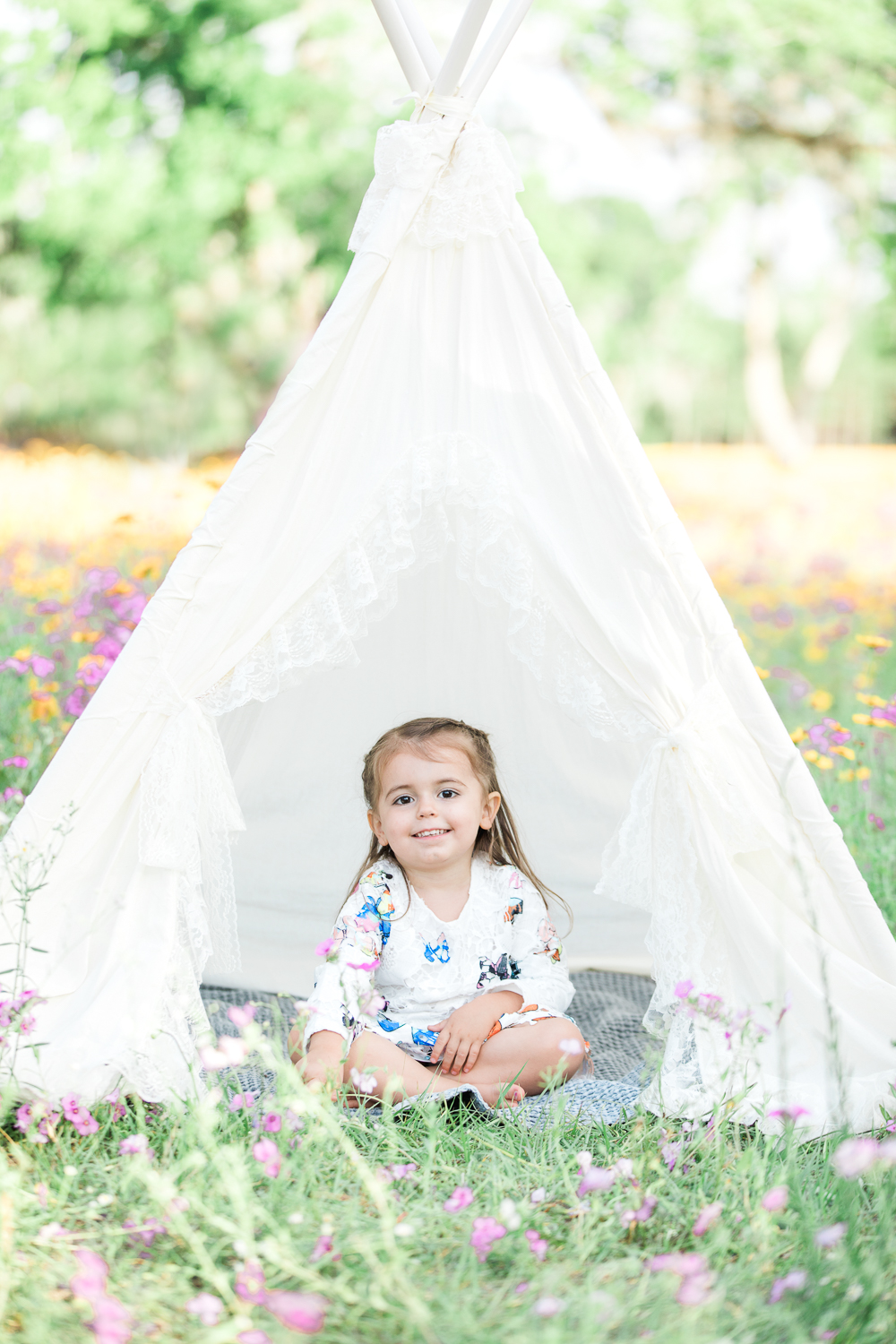 flower field photos with a teepee tent
