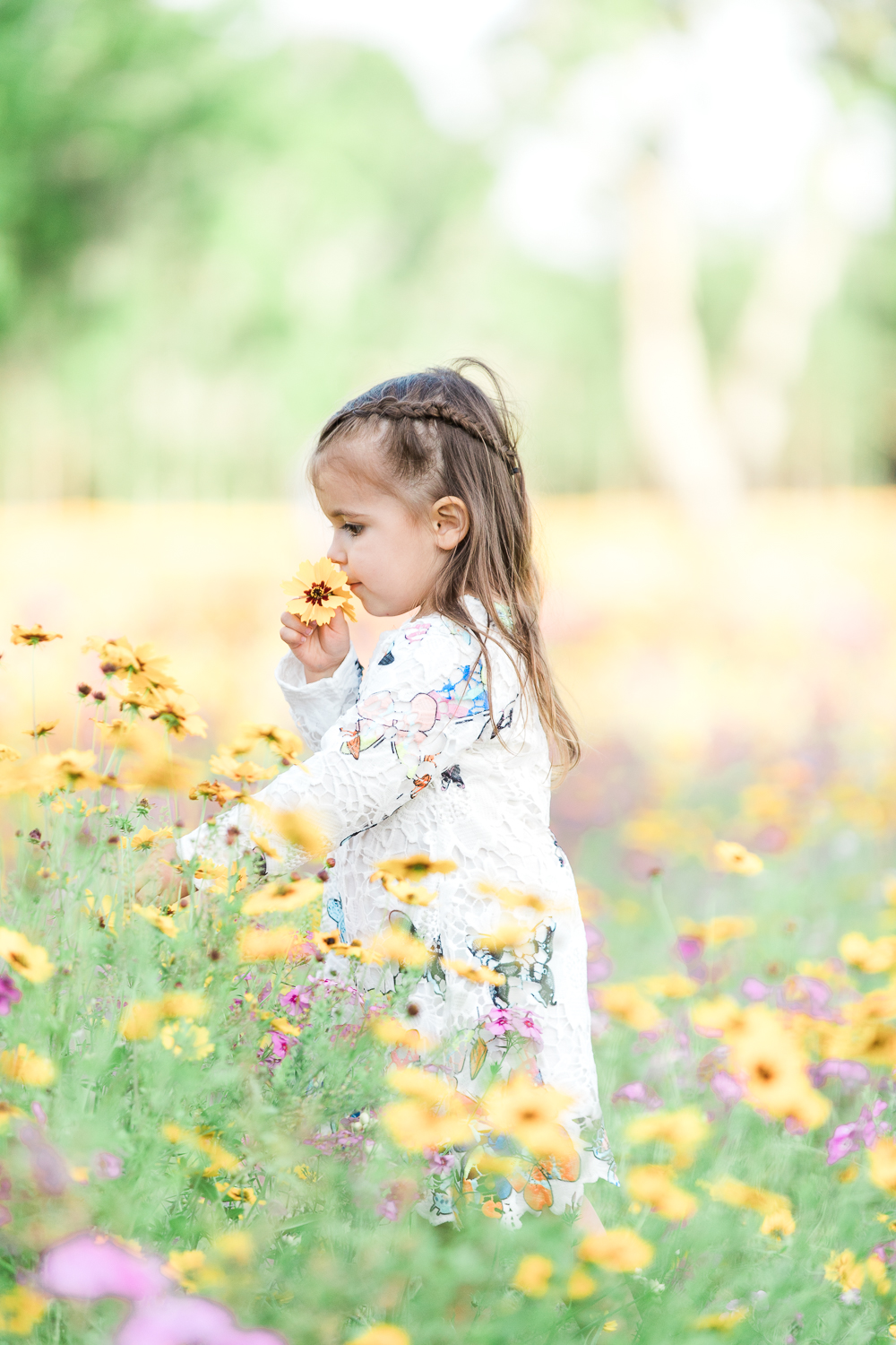 smelling flowers in a flower field near jacksonville, fl