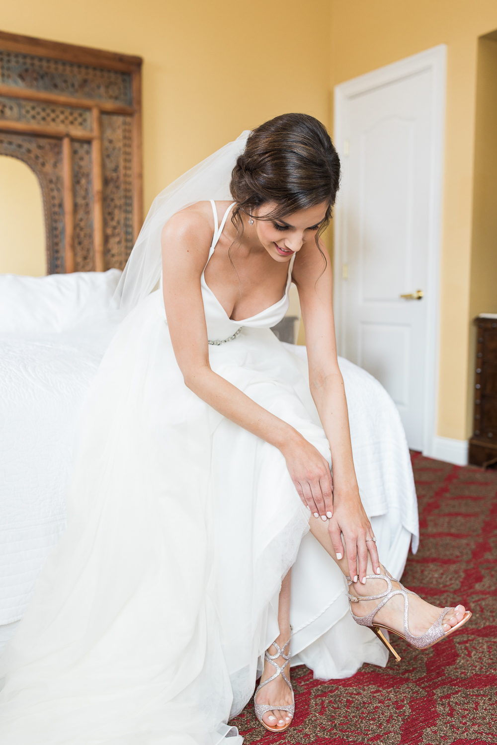 Bride getting her Jimmy Choo heels on
