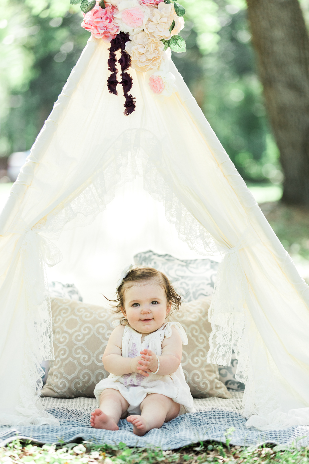 first birthday pictures with a teepee tent