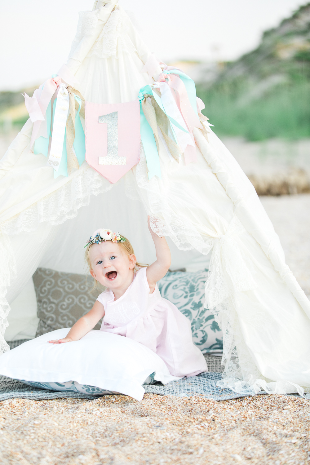 first birthday session at the beach with a teepee tent