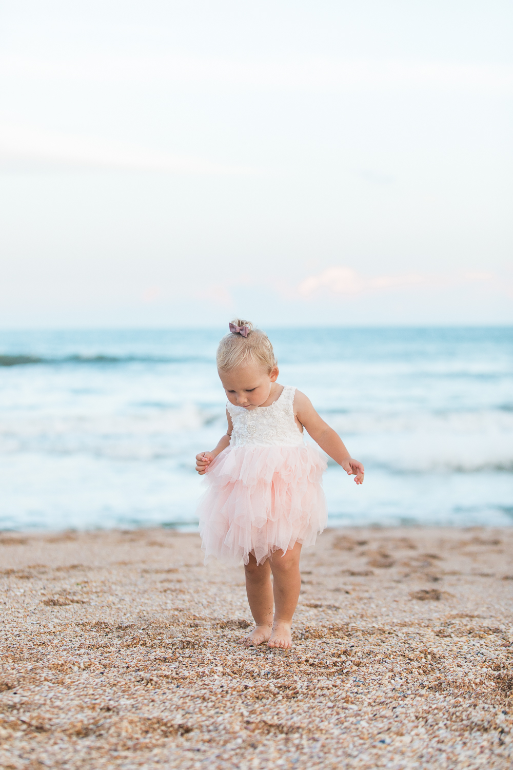 Lace dress with pink ruffles