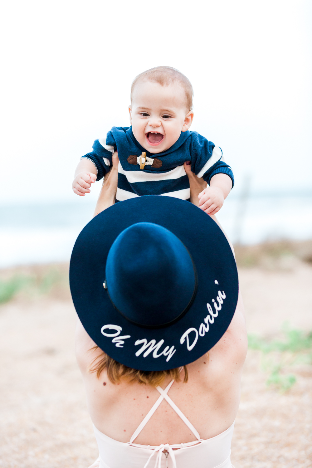 family photoshoot at the beach with a toddler