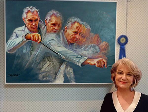 Salwa with her award winning portrait of Paul Ryan