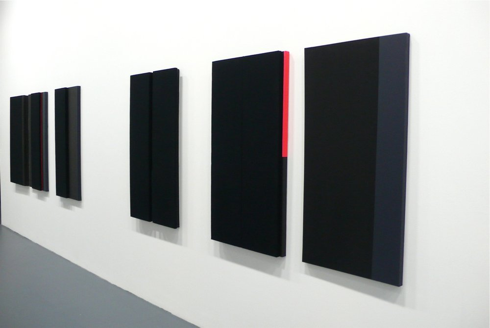 Installation shot of Jennie C. Jones's paintings using acoustic absorber panels.