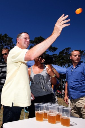 John Key playing beer pong