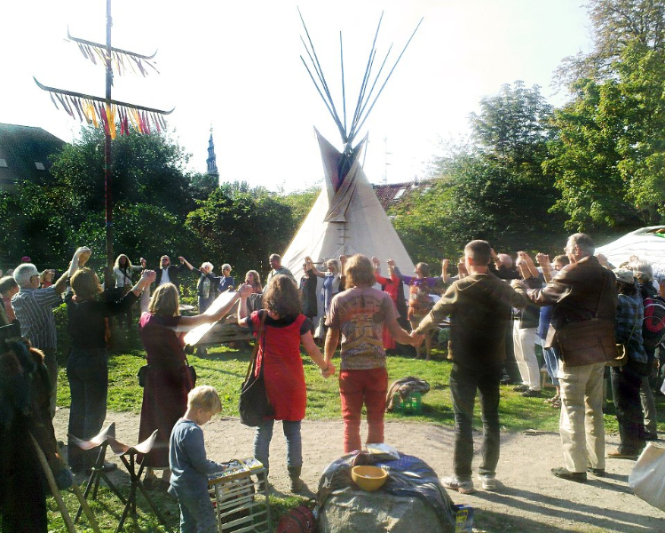 christiania circle of people holding hands.jpg