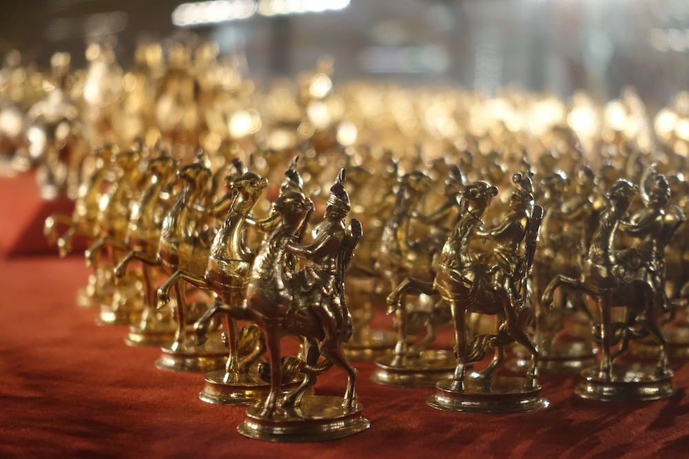 close up of gold soldier figurines
