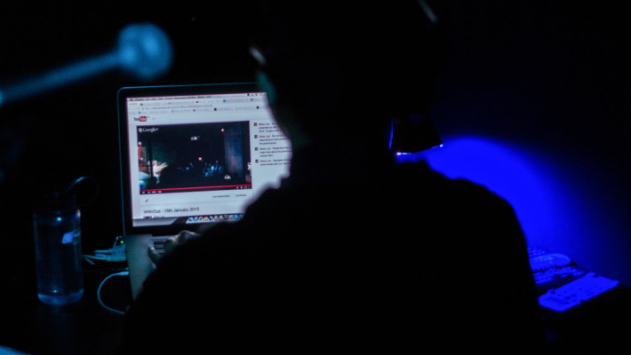 Photo: Yusri Sapari. Zihan monitoring the 'live' webcast of the performance.