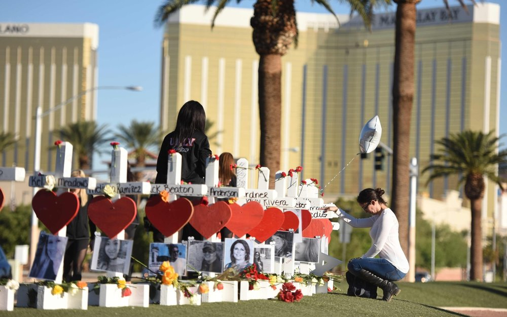 A memorial to the victims of the mass shooting in Las Vegas.  Credit Robyn Beck/Agence France-Presse — Getty Images