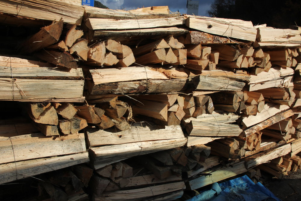 A lot of wood is needed for to fire the kiln for one week straight. It is neatly packed for quick access.