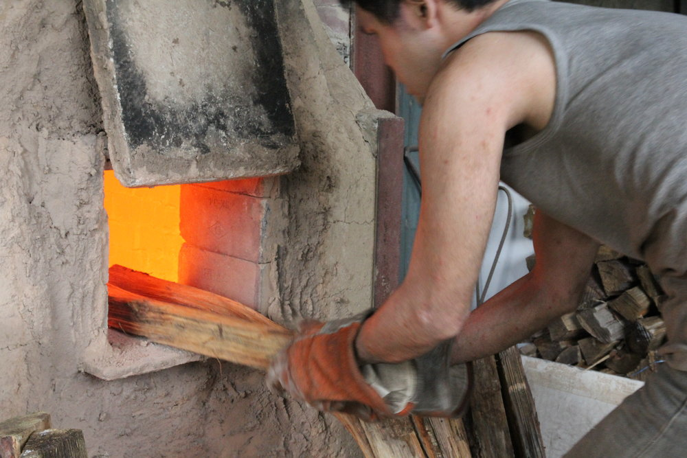 For one week, Ando adds new firing wood every 5 to 10 minutes.