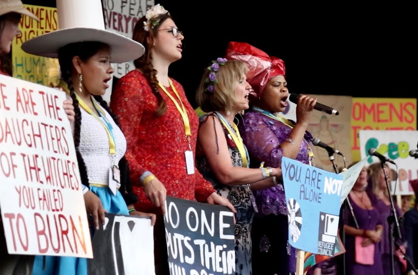 Women activists singing at the rally.jpg