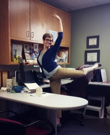 Mikal takes a break in her office to put some of her own lessons from the barre into practice.