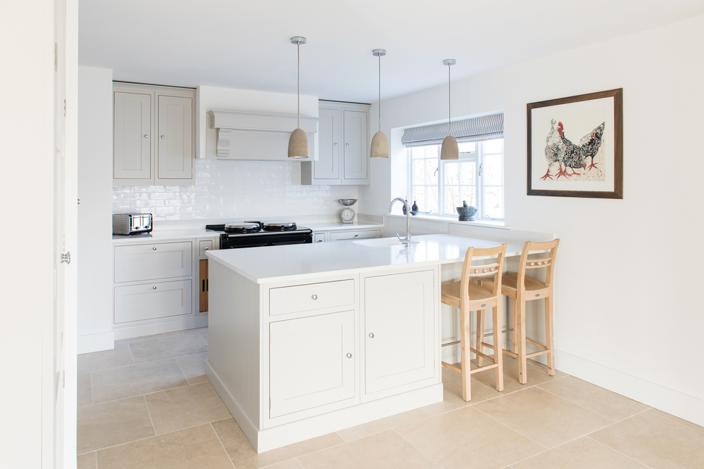 Shaker style peninsula with sink and seating painted in Farrow & Ball Pavilion Gray